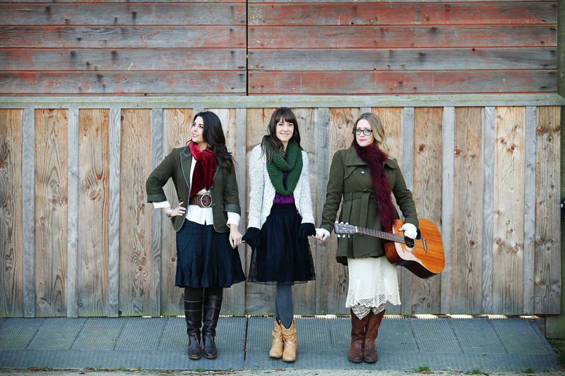 by: PHOTO COURTESY OF JENNY SPRINGER - Wilsonville singers (L-R) Christina Cooper, Naomi LaViolette and Michele Van Kleef pose in front of the historic Stein-Boozier Barn at Murase Plaza.