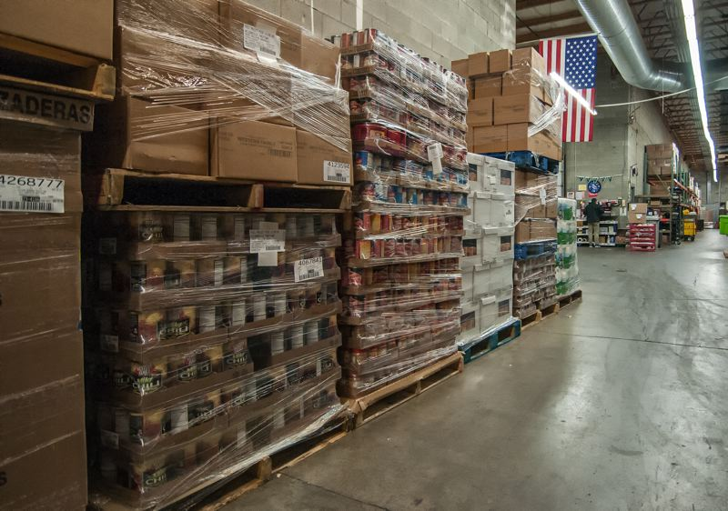 by: SPOKESMAN PHOTO: JOSH KULLA - These pallets of food were delivered to the Wilsonville Lambs Thriftway Monday morning. Its just a fraction of what will be given away this year as part of the companys Food Box Program.