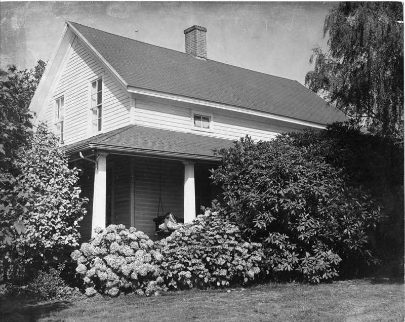 by: SUBMITTED PHOTO - The Carman House, shown here in the 1950s, has been standing in Lake Oswego for 158 years. A decision by the city council on keeping its historic landmark designation will determine if it will continue to stand.