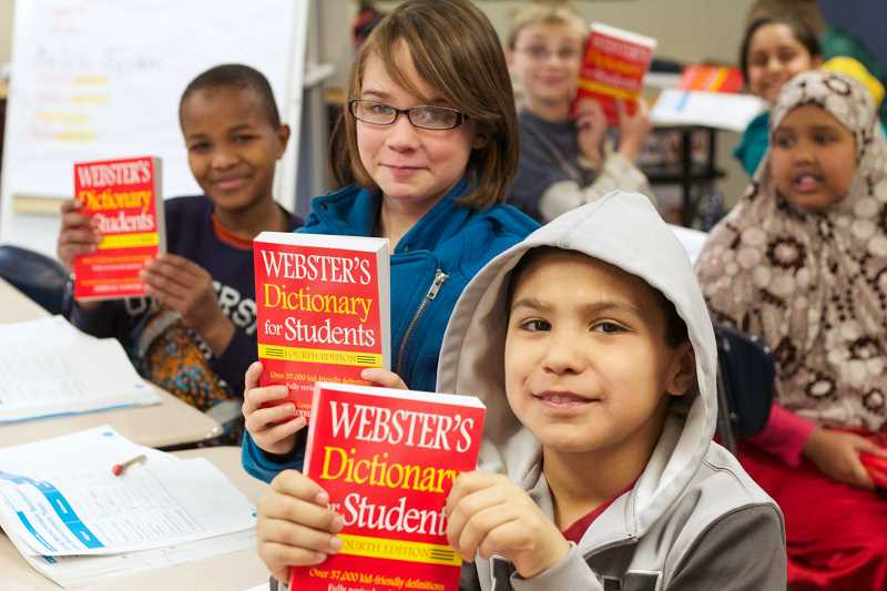 by: EVAN THOMAS - Students in Wendy Murray's fourth-grade class at Heritage Elementary School in Woodburn show off their new dictionaries, which were donated to all local fourth-graders by Woodburn Rotary members on Thursday.