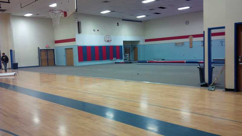 by: SUBMITTED - The unsafe bleachers were taken out, leaving a blank space in the gymnasium that will be filled with new, up-to-code bleachers over the holiday weekend by a construction company. The new bleachers will follow ADA regulations and will also come with remote controls.