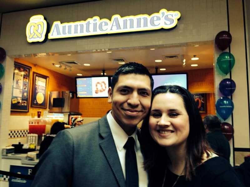 by: COURTESY OF ELEAZAR PUENTE - Woodburn resident Eleazar Puente and his wife Andrea stand in front of Eleazar's own Auntie Anne's store at Lloyd Center in Portland, which opened last week.