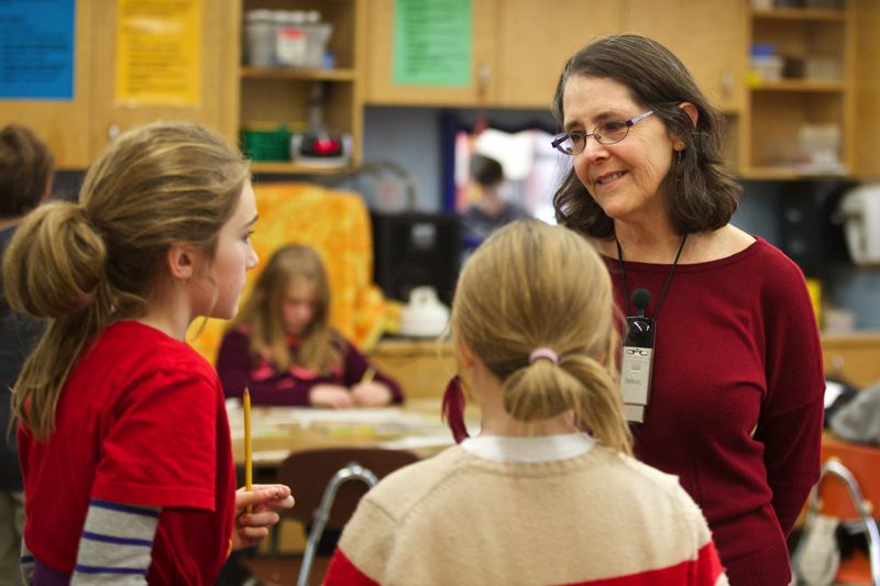 by: TRIBUNE PHOTO: JAIME VALDEZ - Janice Avidan teaches math to her 4th-graders at Buckman Elementary School. Shes one of about 100 Portland Public Schools teachers who filed to retire last week, the highest number in several years.