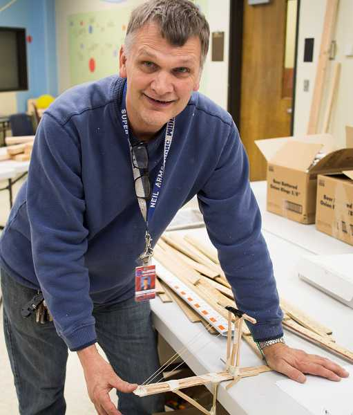 by: NEWS-TIMES PHOTO: CHASE ALLGOOD - Science teacher Paul Burnett plans to retire this month from Neil Armstrong Middle School. Hes one of 15 Forest Grove School District employees who opted for retirement this month in the wake of changes to the compensation formula for Oregon Public Employees Retirement System workers.