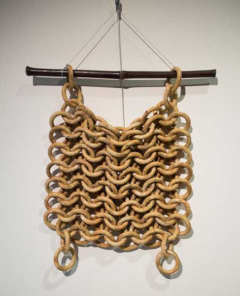 by: NEWS-TIMES PHOTO: CHASE ALLGOOD - Chain Mail by  guest artist Tony Furtado is a ceramic piece with an oxide wash.