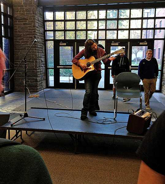 by: REVIEW PHOTO: JILLIAN DALEY - LOHS freshman Alexius Harris performs during the first Friday Break Live on Nov. 22.