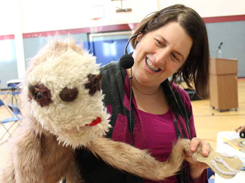 by: REVIEW PHOTO: JILLIAN DALEY - Canadian author Kari-Lynn Winters poses with her puppet, Sloth, from her book, Jeffrey and Sloth. For her presentation to Oak Creek, Winters wore bee antennae and a chicken hat.