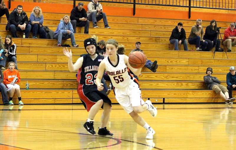 by: CORY MIMMS - Josie Child cuts past Tillamook's defense.