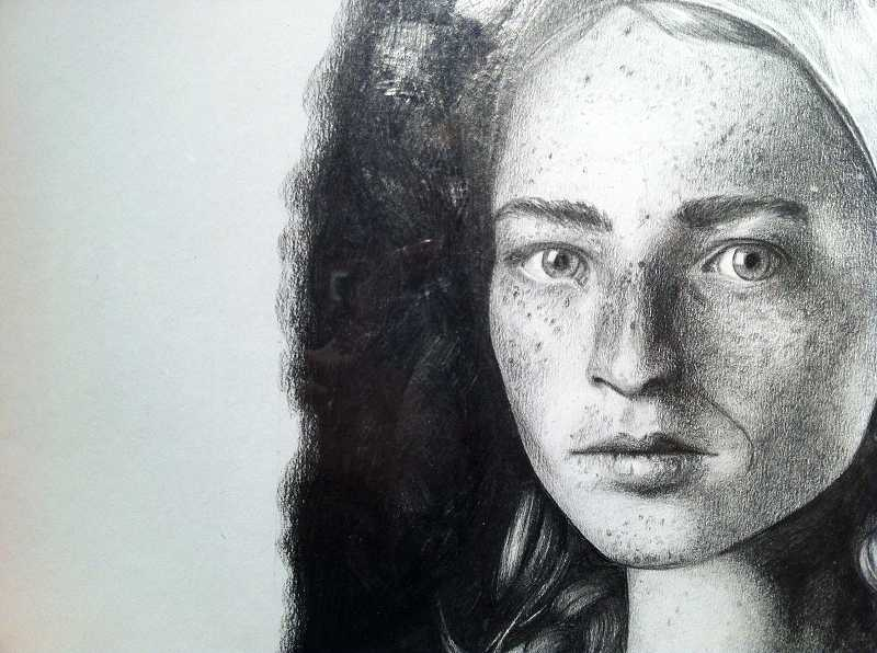 by: COLLEEN CORNISH - This portrait of a young woman by Tony Mull for Advanced Drawing class is rendered in pencil.