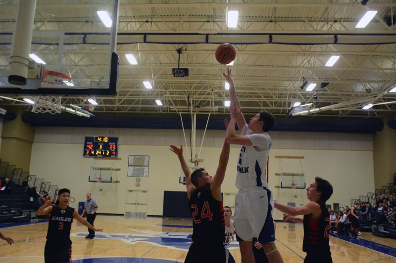 by: TIMES PHOTO: MATT SINGLEDECKER - Valley Catholic senior post Gabe Taylor gets off a floater over a Westside Christian post in the third quarter of the Valiants' win over the Eagles on Tuesday. Taylor finished with 26 points despite sitting out the fourth.