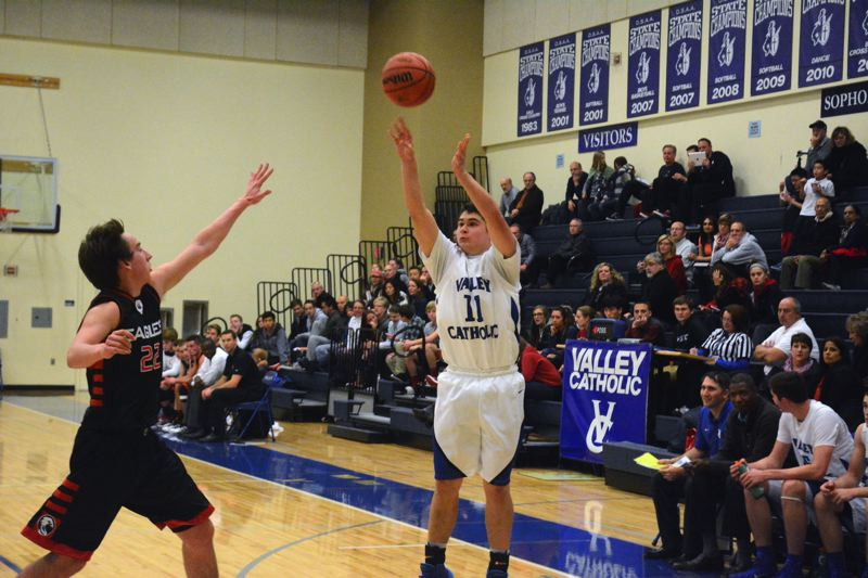 by: TIMES PHOTO: MATT SINGLEDECKER - Valley Catholic junior wing Kazmua Lane hits a three-pointer at the end of the third quarter for the Valiants, who ran away from Westside Christian in the second half on Tuesday for the victory.