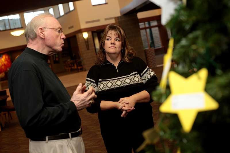 by: TIMES PHOTO: JONATHAN HOUSE - Rick Anderson, communications coordinator at Sunset Presbyterian Church, left, and Christina Mackin talk about the importance of the partnership between the church and Beaverton schools during the holiday  season.