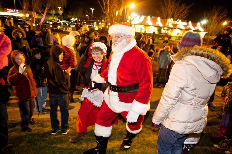 by: TIMES PHOTO: JAIME VALDEZ - Mr. and Mrs. Claus arrive at Liberty Park for the Tigard Tree Lighting on Friday night.