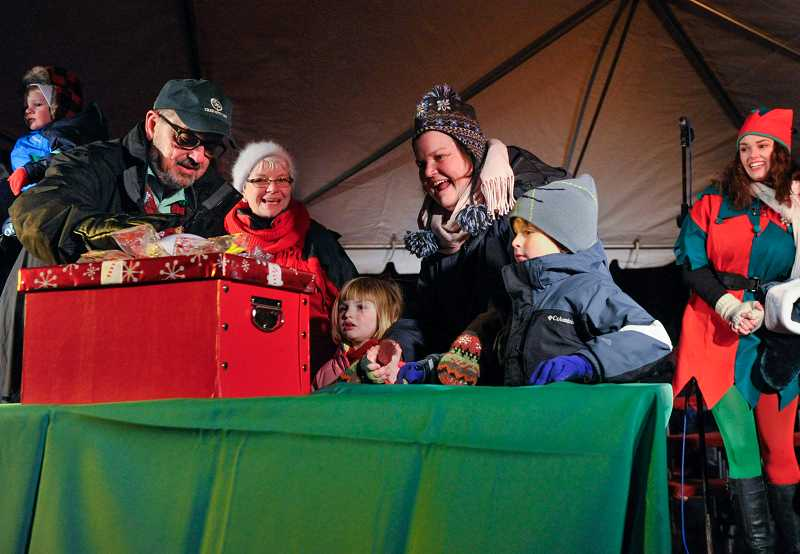 by: TIMES PHOTO: JOHN LARIVIERE - Caylin Winkels, 5, and Jack Wolff, 5, help Beaverton Mayor Denny Doyle press the switch to turn on the lights for the city of Beaverton Christmas tree during Friday night's gathering in Beaverton City Park.