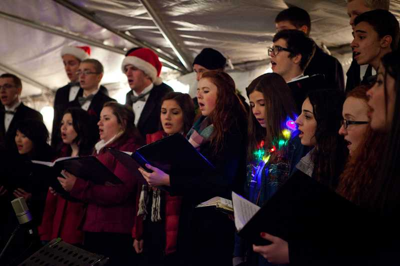by:  TIMES PHOTO: ADAM WICKHAM - The Tualatin High School Crimsonnaires perform at the Tualatin Starry Nights and Holiday Lights Festival on Friday night.