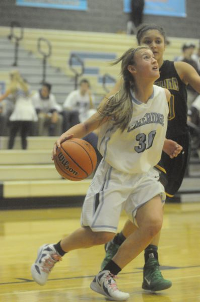 by: MATTHEW SHERMAN - Natalie Bristol led Lakeridge with 19 points in an early win over Madison and is the team's starting point gard this year.