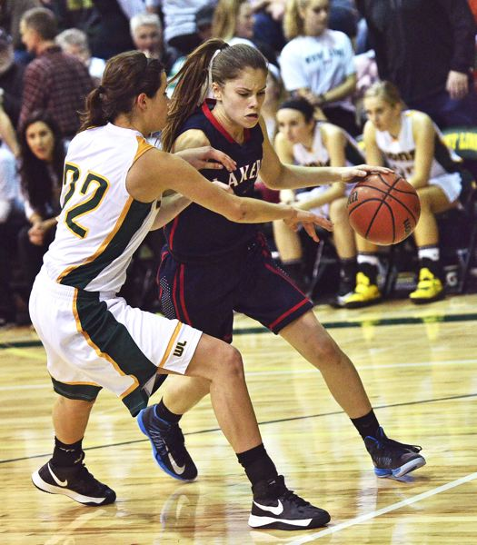 by: VERN UYETAKE - Hannah Plott has been an impressive defensive force for a young but optimistic Lake Oswego team this year.