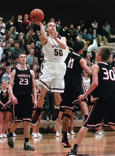 by: DAN BROOD - SCOOP IT UP -- Tualatin senior guard Joey Fishback goes to the basket during the Timberwolves' game with Oregon City. Fishback is expected to be one of the team leaders this season.
