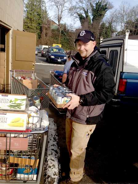 by: CONTRIBUTED PHOTO - Northwest Technologies employees donated more than 1,700 pounds of food to the Estacada Area Food Bank. Nick Brown participates in the Civil War food drive.