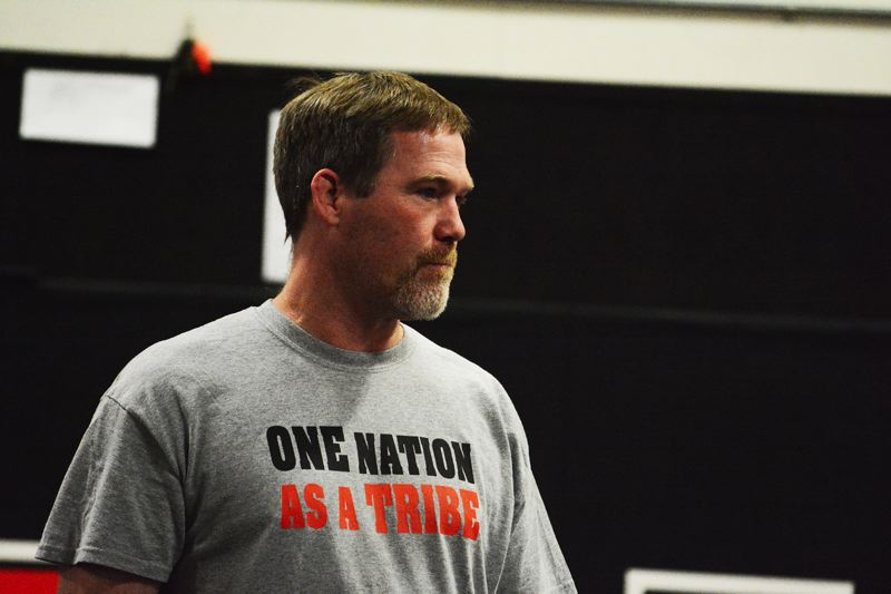 by: JOHN WILLIAM HOWARD - Scappoose wrestling coach Jim Jones oversees practice this week on Wednesday afternoon.
