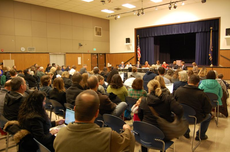 by: PHOTO BY: RAYMOND RENDLEMAN - Concord Elementary School parents pack the Sabin-Schellenberg Skills Center auditorium to protest the closure of their school beginning next year.