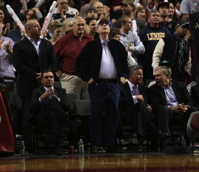 by: TRIBUNE PHOTO: JONATHAN HOUSE - Trail Blazers owner Paul Allen checks the score late in the game against Oklahoma City this season.