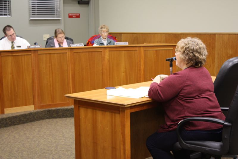 by: SPOTLIGHT PHOTO: ROBIN JOHNSON - Beth Kaye, HEAL Cities Campaign manager, sits before the Scappoose City Council to explain the dangers of increasing obesity rates and how joining the HEAL campaign might better position the city to build an environment that fosters healthy living.