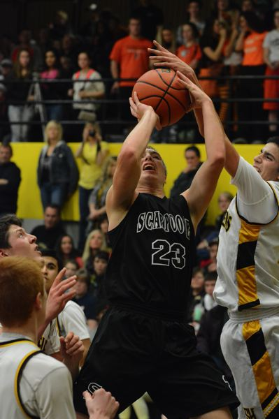 Taylor Loss gets blocked by Lion senior Michael Enyart in the fourth quarter of the Indians' 62-49 loss at St. Helens.