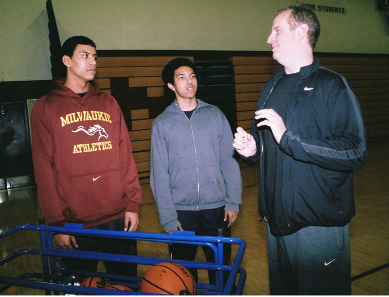 by: JOHN DENNY - Milwaukie coach Scott Bays discusses strategies with team co-captains Tyler Spencer (left) and Matthew Chilberg. The Mustangs have high aspirations despite losing all but one player from last years varsity that advanced to the final eight at Knight Arena.