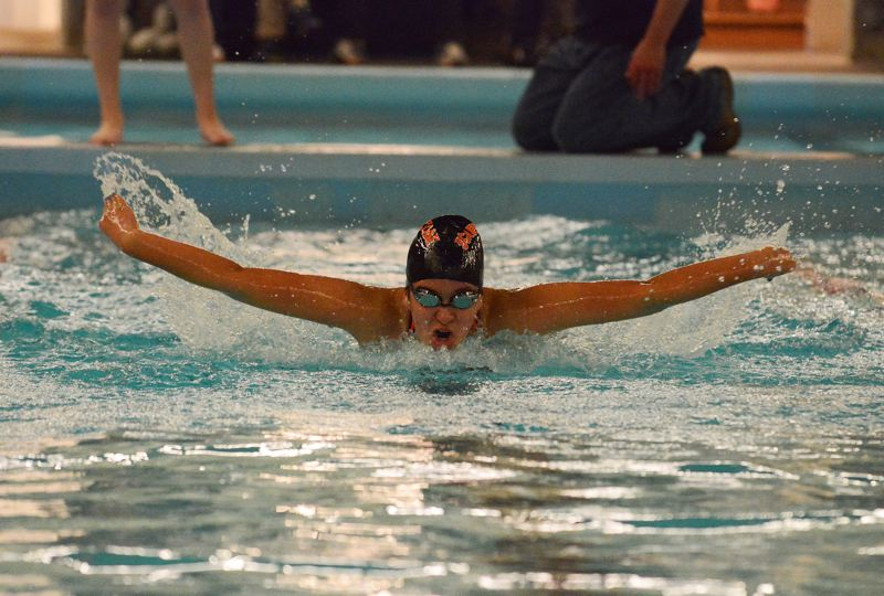 by: JOHN WILLIAM HOWARD - Junior Stefany Alvarez competes in the girls' 100 meter butterfly last Friday afternoon at the River City Invite. The meet was a success for Alvarez, who finished second in the butterfly and won the 100 meter breast stroke with a new personal best.