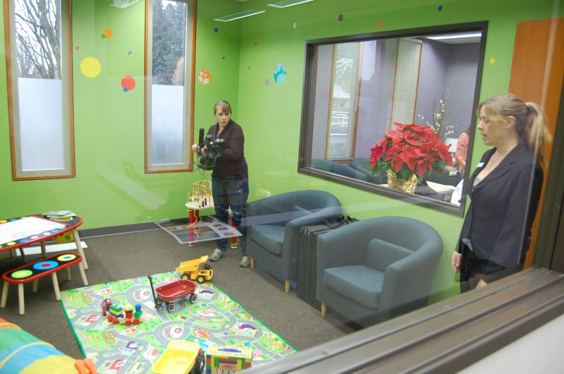 by: PHOTO BY: RAYMOND RENDLEMAN - Clackamas Womens Services Executive Director Melissa Erlbaum takes media members on a tour through the kids playroom at A Safe Place, Clackamas County's newly opened Family Justice Center for comprehensive domestic-violence prevention services.