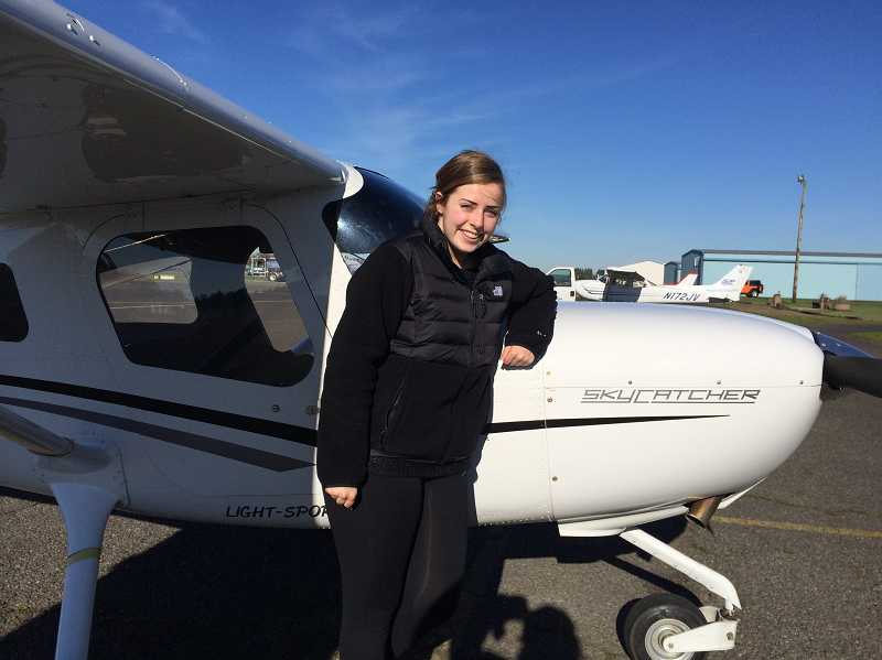 by: SUBMITTED PHOTO - Wiegand earned her private pilots license at Aurora Aviation last month.