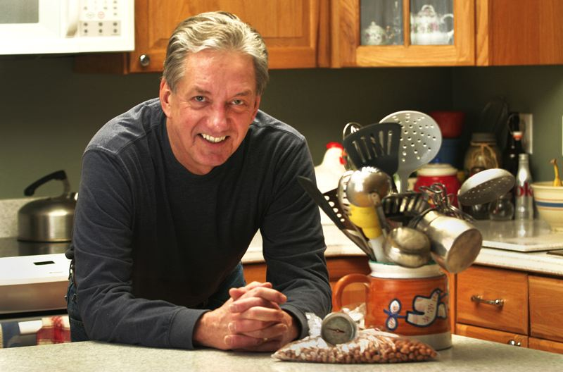 by: OUTLOOK PHOTO: JIM CLARK - Gary Rankin has been making his peanut brittle for more than 40 years, as a homemade gift for family and friends.