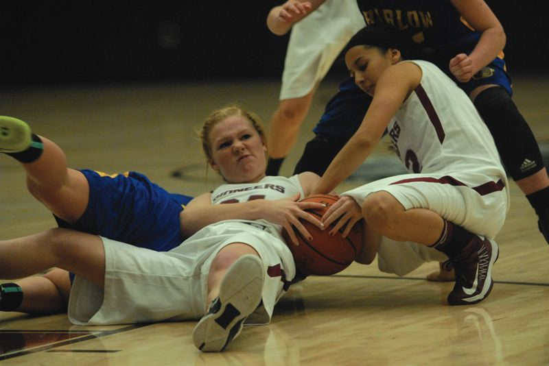 by: SANDY POST: DAVID BALL - Sandys Makenna Wells gets on the floor to force a jump ball, while teammate Paola Phipps lends a helping hand during Mondays loss to Barlow.