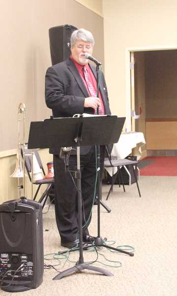 by: MAYGAN BECKERS - Jack Quinby, local musician, leads a Christmas sing-along at the monthly Chamber Forum Lunch on Wednesday.