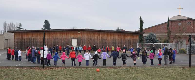 by: SUBMITTED - Students and staff at Sacred Heart Catholic School in Gervais gathered on the blacktop at noon Dec. 10 to join in Pope Francis' proclamation to pray for the end of world hunger.