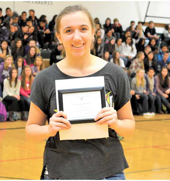 by: LINDSAY KEEFER - Noelle Prescott receives her Commended Student certificate during a recent North Marion High School assembly.
