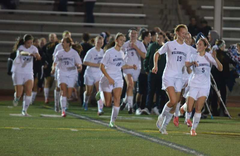 by: JEFF GOODMAN / FILE - The Wilsonville girls soccer team ranked second in Class 5A with a combined grade-point average of 3.83. Above, members of the team celebrate their shutout of Sherwood at home Oct. 17
