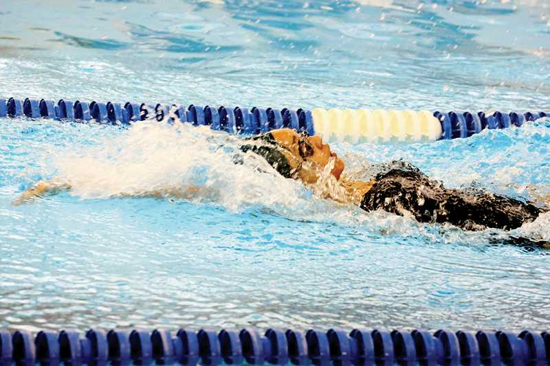 by: JO WHEAT - North Marion senior Veronica Norris won her opening race of the season in the 100 backstroke with a time of 1:07.87 at the Canby Invitational Dec. 9.