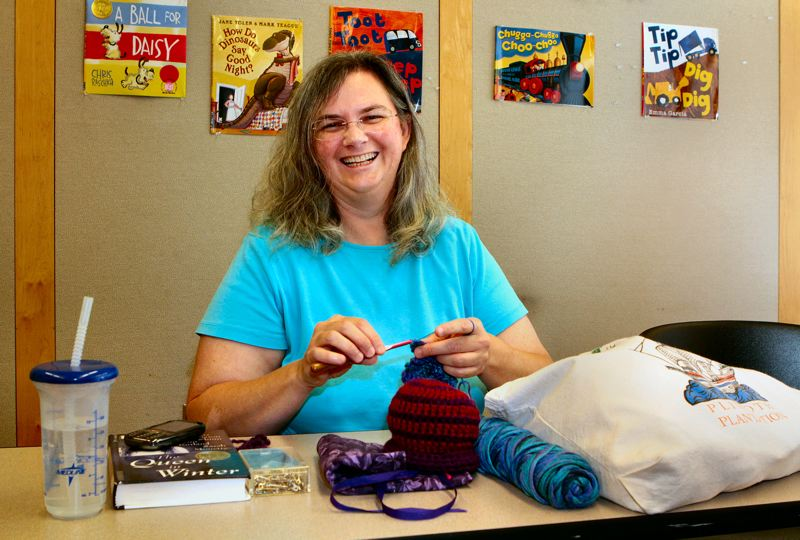 by: DAVID F. ASHTON - Crafter Laura Rose knits infant hats which the web-based http://www.HYPERLINK http://clickforbabies.org/ clickforbabies.org distributes as part of their Period of Purple Crying campaign.