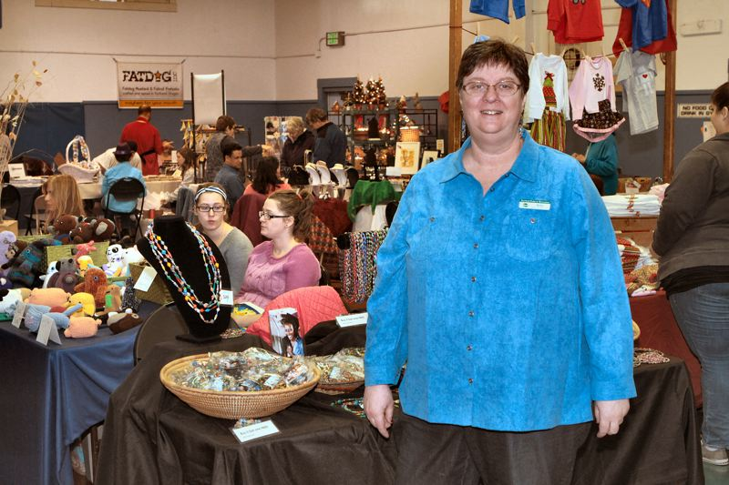 by: DAVID F. ASHTON - Sellwood Community Center Director Kim Calame welcomes vendors and shoppers to their the annual Snowflakes Holiday Bazaar.