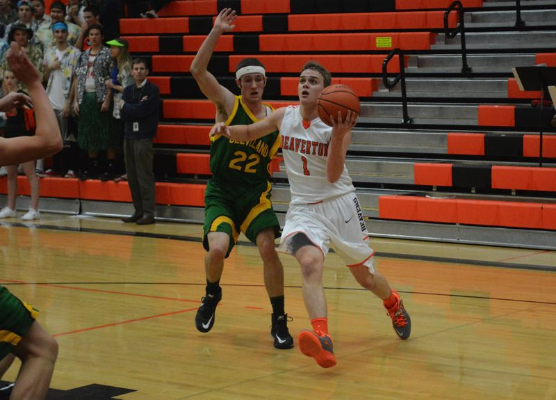 by: TIMES PHOTO: MATT SINGLEDECKER - Beaverton senior point guard Martin Tannler led the Beavers with 14 points and 5 assists against Cleveland.