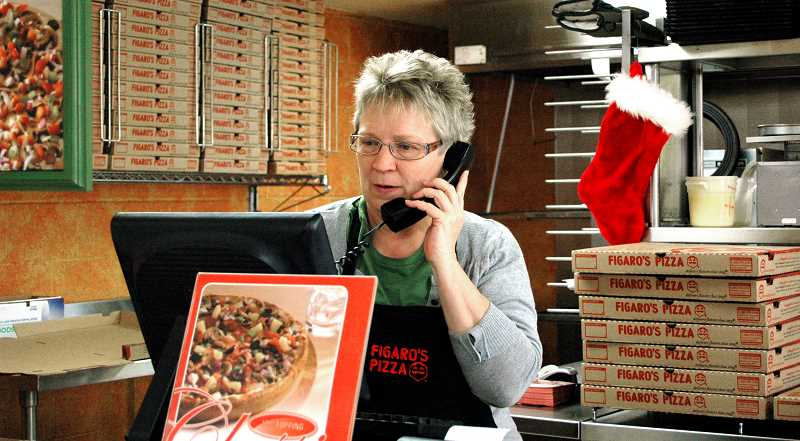 by: ISABEL GAUTSCHI - Tamara Pugh takes an order. Pugh has owned Figaro's Pizza in Estacada for 17 years.