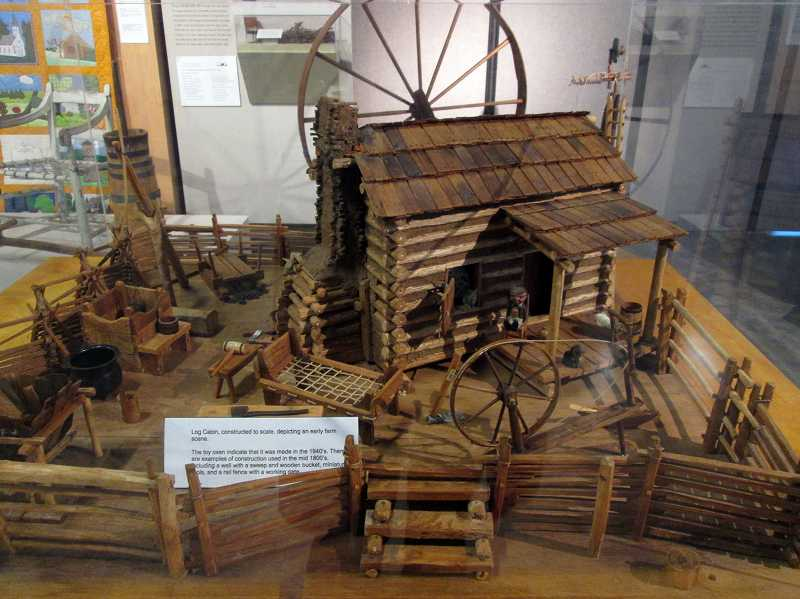 by: COURTESY PHOTO - A model log cabin at the Washington County Museum will help campers visualize their Homesteading experience on Day Two of Winter Break Camp and some of the chores theyll have to practice.