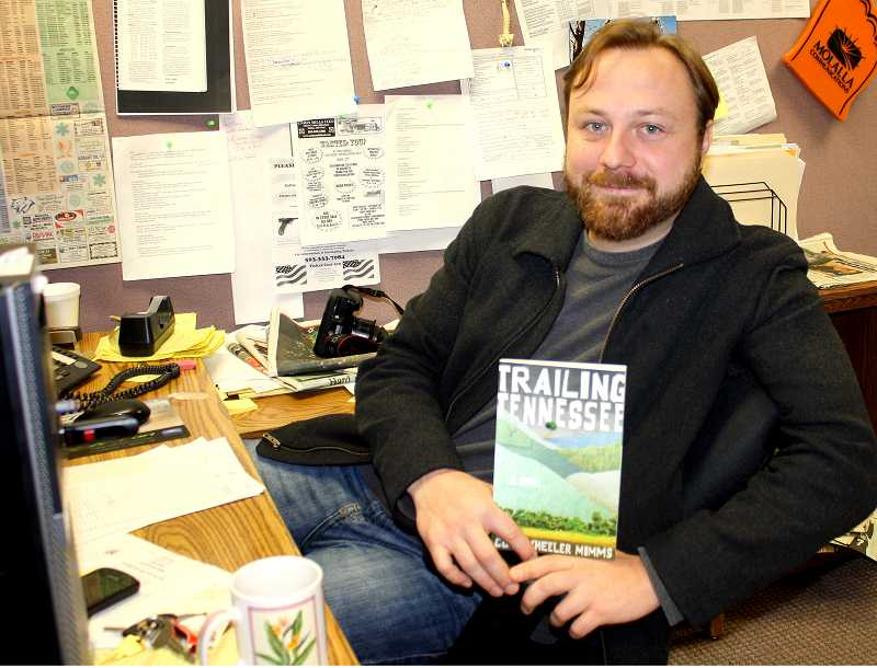 by: PEGGY SAVAGE - Author and sports writer Cory Mimms at his desk. Mimm's new book, 'Trailing Tennessee,' was published in October.
