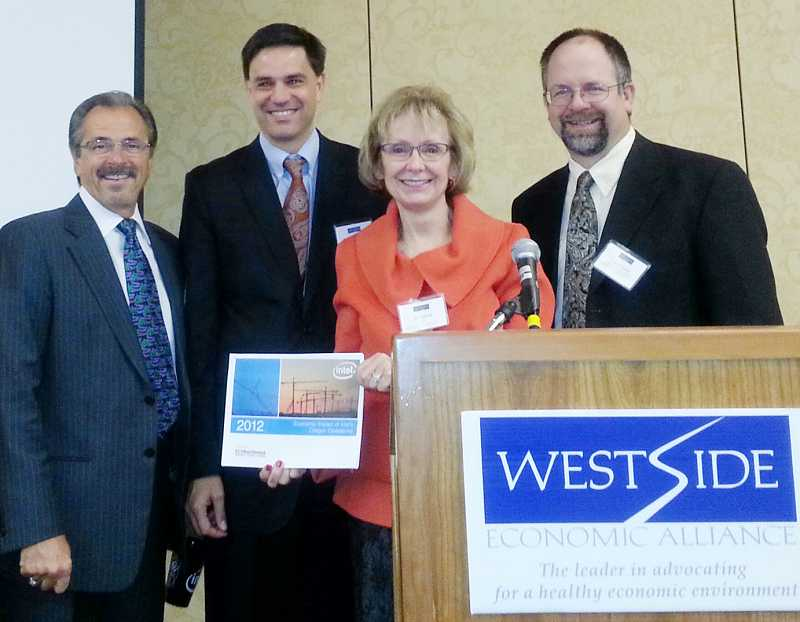 by: COURTESTY PHOTO: CHELSEA HOSSAINI, INTEL - From left to right at the Westside Economic Alliance breakfast is Hillsboro Mayor Jerry Willey, ECONorthwest President John Tapogna, Intel Coporate Affairs Director Jill Eiland and Washington County Chairman Andy Duyck.