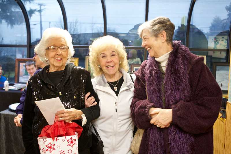 by: TIMES PHOTO: JAIME VALDEZ - Ardith Tall, Dolores Banton and Prisca King pose for a picture during Tall's 95th birthday at McDonald's restaurant in Beaverton along Southwest Beaverton-Hillsdale Highway.