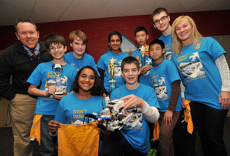 by: REVIEW PHOTO: VERN UYETAKE - Dont Panic and Always Carry a Towel presented its trophies from a robotics tournament to Robert Caplinger, principal of Lake Oswego Junior High, the school most of the team members attend: from left, front row: Michael Quattromani, Divya Kumar, Brendan Schaezler, Jeffery Ma, Esther Schaezler (coach); back row: Robert Caplinger, Adrian Edwards, Anushka Nair, Zhangxiang Lu and Ethan Schaezler.
