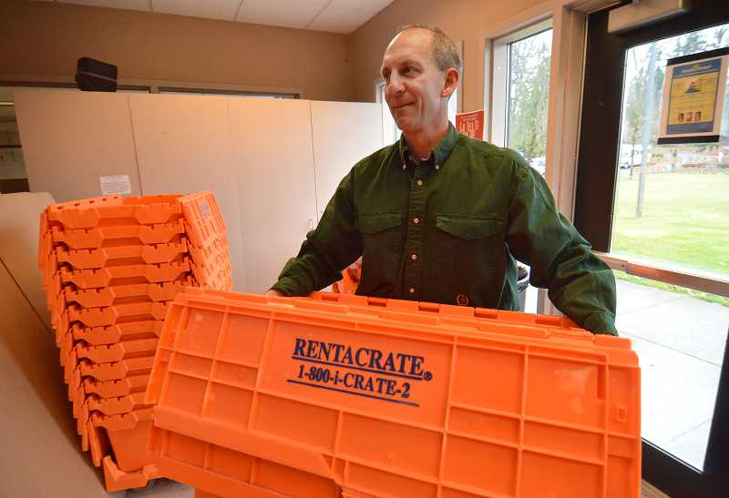 by: REVIEW PHOTOS: VERN UYETAKE - Westside Academic Dean Scott Ball helped prepare for the big move this week.