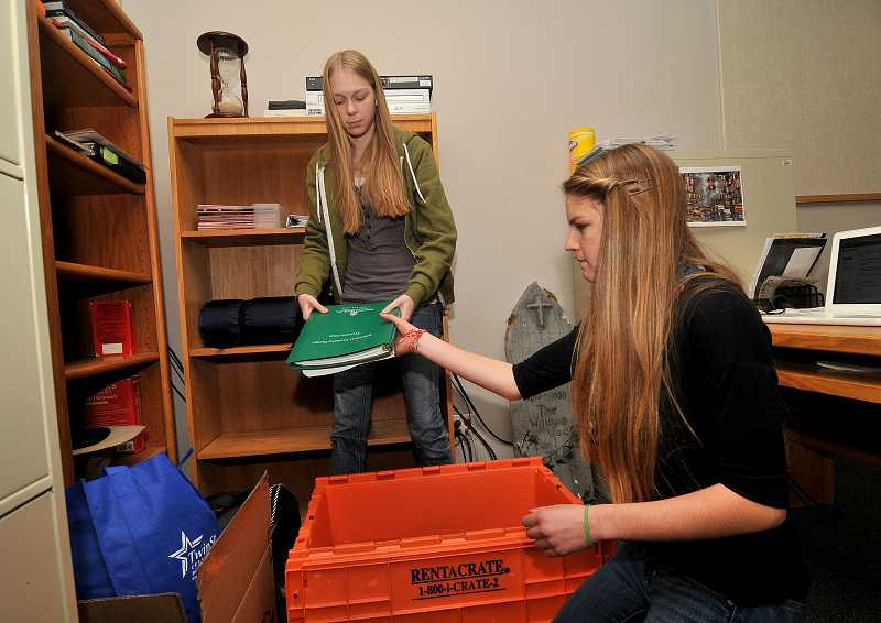 Westside seniors Meleah Williamson, left, and Sarah Curtis help out during moving week.